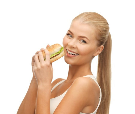 picture of healthy woman eating junk food Stock Photo - 19146263