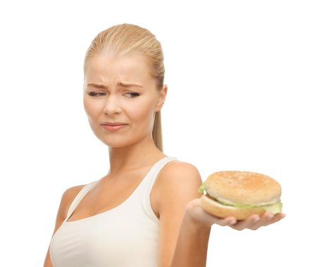 picture of healthy woman rejecting junk food photo