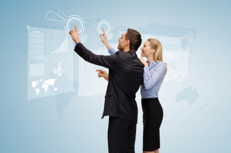 pointing device: picture of man and woman working with virtual screen Stock Photo