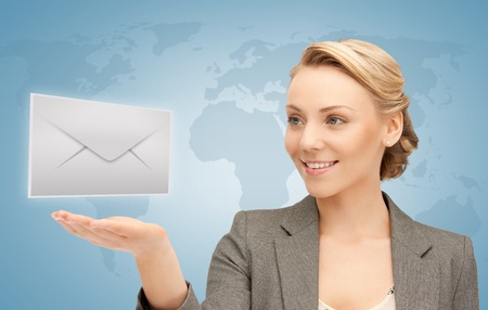 electronical: woman with world map showing virtual envelope Stock Photo