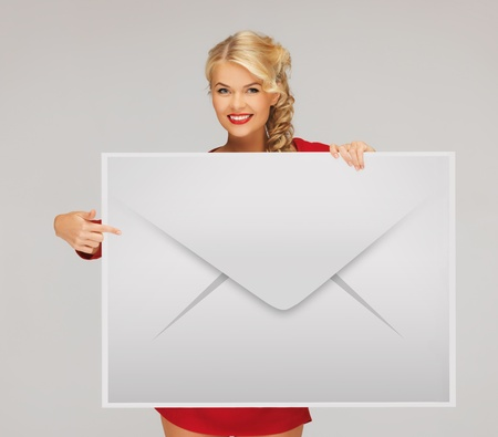 picture of smiling woman showing virtual envelope Stock Photo - 19207148