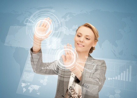 high tech world: picture of attractive businesswoman touching virtual screen
