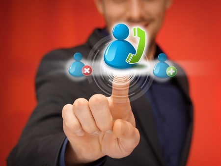 close up of businessman pressing virtual contact icon photo
