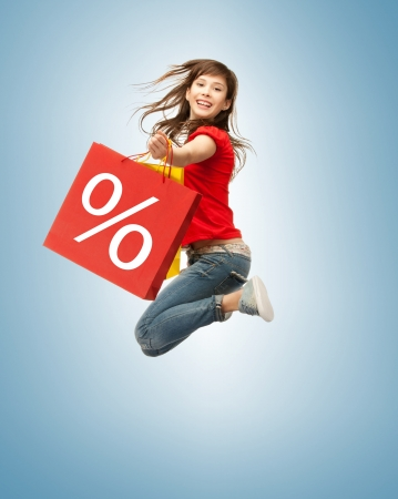 shopping bag icon: picture of jumping teenage girl with shopping bags Stock Photo