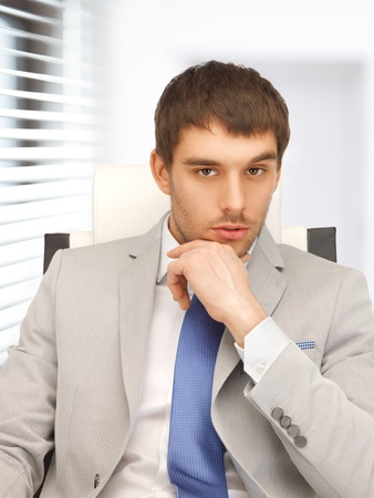 picture of young businessman sitting in chair Stock Photo - 19207392