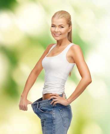 picture of sporty woman showing big pants photo