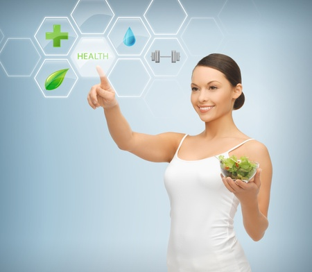 healthy person: woman holding salad and working with menu on virtual screen