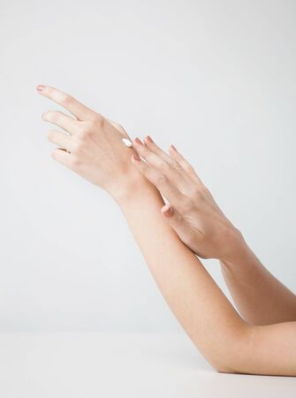 handcare: close up of female soft skin hands with creme