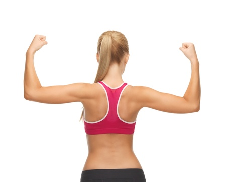 arms raised: picture of young sporty woman showing her biceps