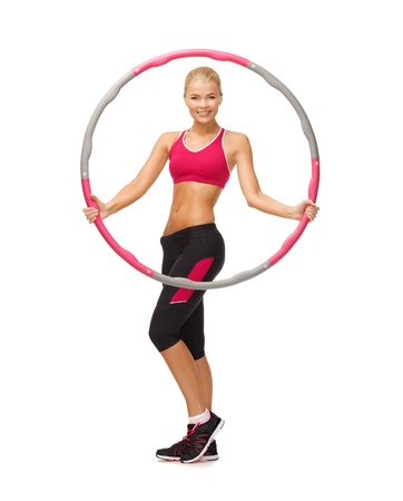 picture of young sporty woman with hula hoop Stock Photo