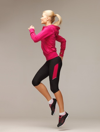 girl in sportswear: picture of beautiful sporty woman running or jumping