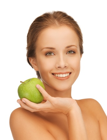 picture of smiling woman with an apple   photo