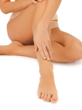 varicose veins: close up of female legs and hand Stock Photo