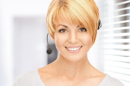 confident consultant: bright picture of friendly female helpline operator