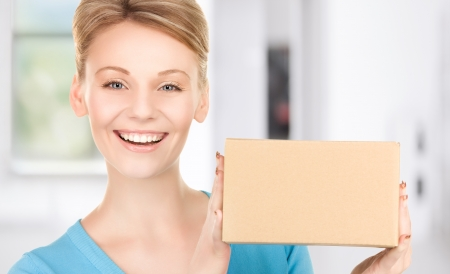 delivery service: picture of businesswoman with parcel in office