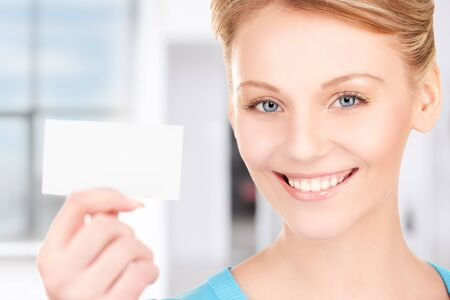 happy woman with business card in office photo