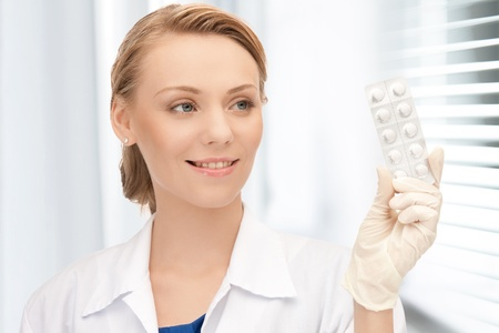 picture of attractive female doctor with pills photo