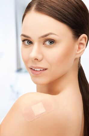 band aid: portrait of beautiful woman with medical patch or plaster