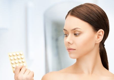 packs of pills: picture of sad young woman with pills Stock Photo