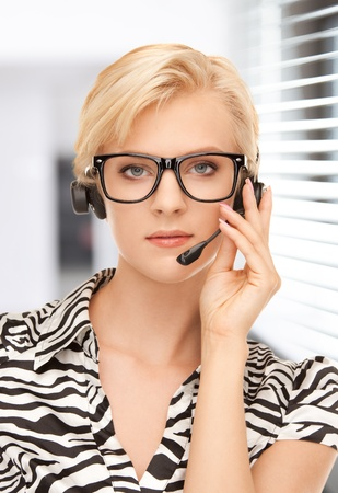 bright picture of friendly female helpline operator Stock Photo - 19229762
