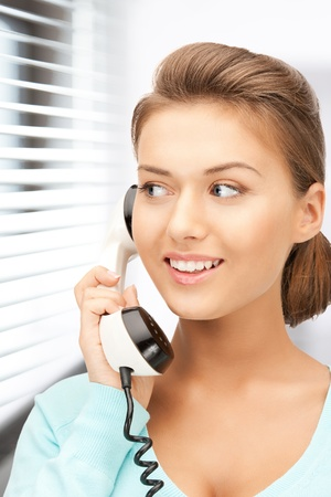 bright picture of calm businesswoman with phone photo