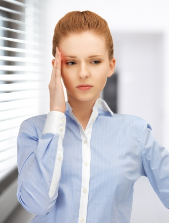 bright picture of unhappy woman in office Stock Photo - 19229982
