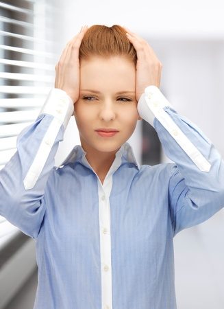 desperate face: bright picture of unhappy woman in office Stock Photo