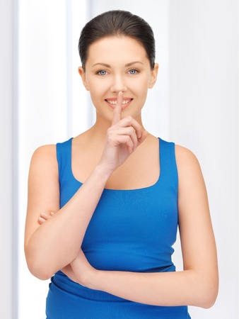 bright picture of beautiful woman making a hush gesture Stock Photo - 19229991