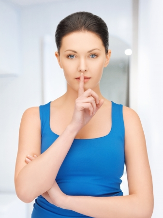 bright picture of beautiful woman making a hush gesture Stock Photo - 19229985