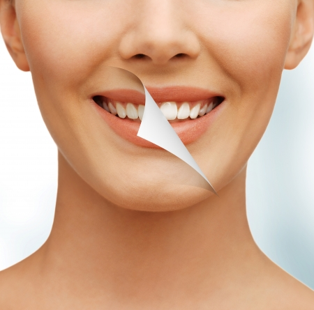 oral care: picture of beautiful woman with white teeth Stock Photo