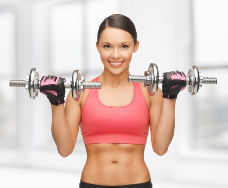weight lifting: picture of beautiful sporty woman with dumbbells