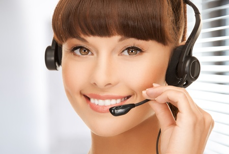 picture of friendly female helpline operator with headphones photo