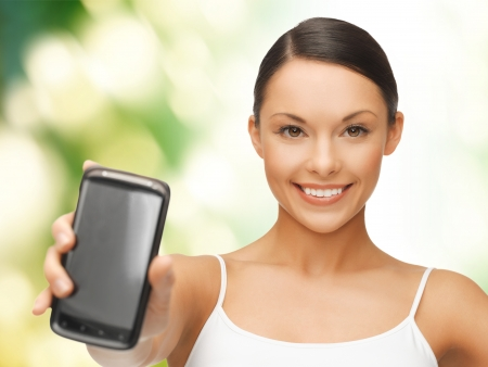 showing muscles: beautiful sporty woman showing smartphone with app