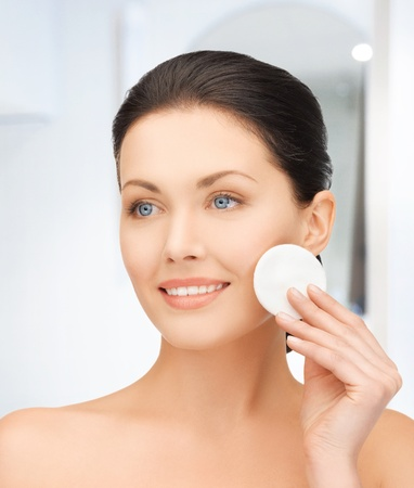removing make up: bright picture of beautiful woman with cotton pad