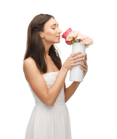 fragrant scents: young and beautiful woman with vase of flowers