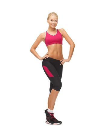 cuerpo femenino perfecto: imagen de hermosa mujer atlética en ropa deportiva Foto de archivo