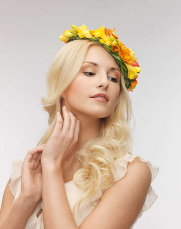 picture of young woman wearing wreath of flowers   photo