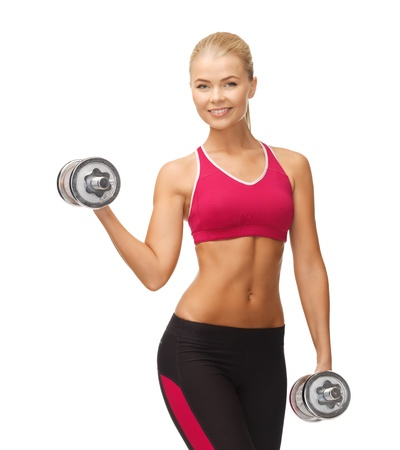 physical fitness: picture of young sporty woman with heavy steel dumbbells Stock Photo