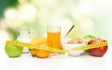 close up of healthy breakfast and measuring tape Stock Photo