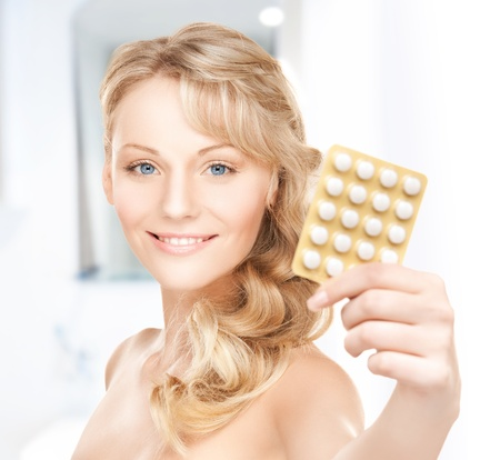 picture of young woman with pills at home photo
