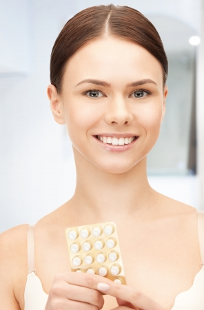 home birth: picture of young beautiful woman with pills