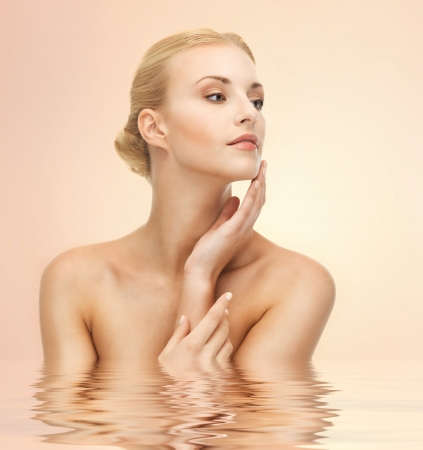 women bathing: portrait of beautiful woman touching her face