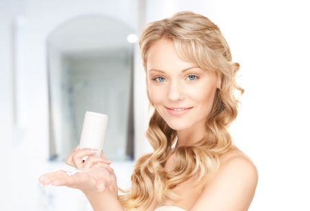 contraception: picture of young woman with pills at home