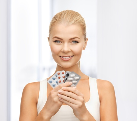 packs of pills: picture of young woman with variety of pills