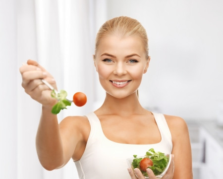 beautiful salad: picture of healthy woman holding bowl with salad