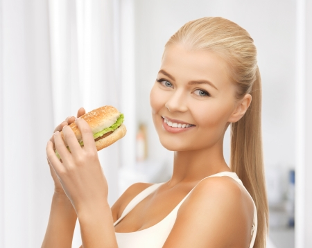 picture of healthy woman eating junk food photo