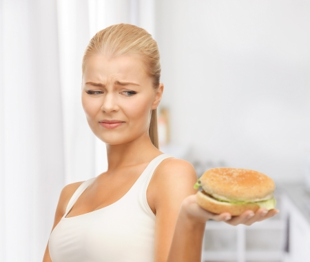 disgusting: picture of healthy woman rejecting junk food Stock Photo