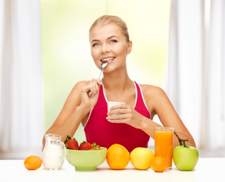 picture of young woman eating healthy breakfast photo