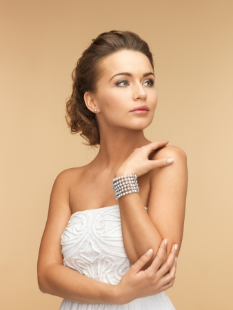 bangle: beautiful bride wearing pearl earrings and bracelet
