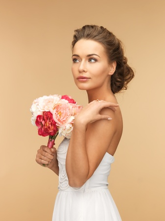 picture of young woman with bouquet of flowers  photo